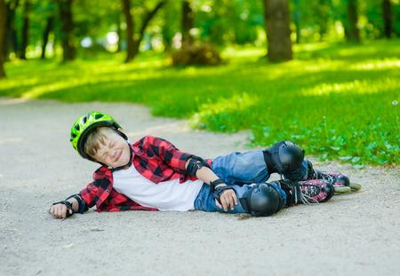 Boy falling on roller skates. 版權商用圖片