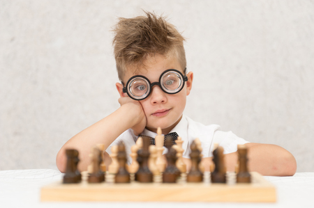 Smart boy is playing chess.