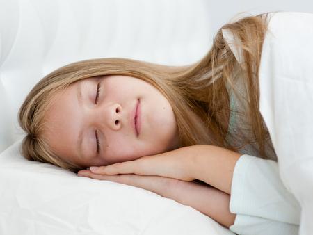 Beautiful teen girl sleeping in bed.