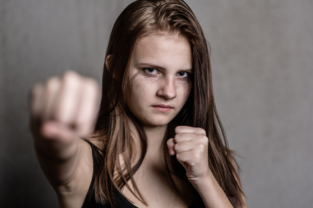 Sad girl  is ready to fight. Stock Photo