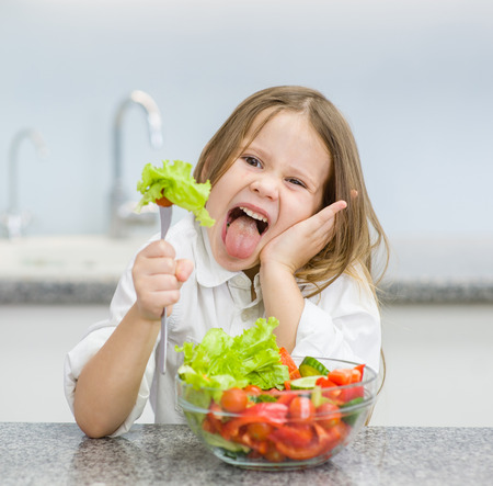little girl refuses to eat vegetable. Stock Photo