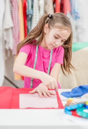 Little girl draws with soap markup patterns. Stockfoto