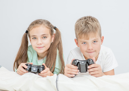 friendly brother and sister playing video games together. Banque d'images