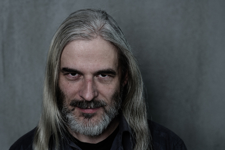 Portrait of an adult man with a gray beard and longhair. Reklamní fotografie
