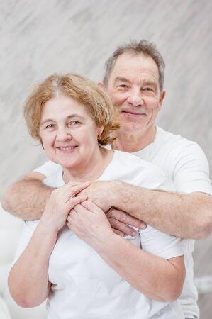 Happy elderly couple. Husband hugging his wife. Stock fotó