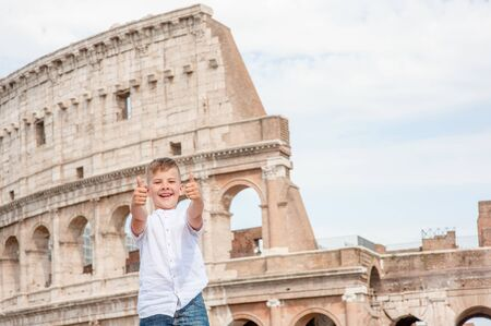 Happy boy showing thumbs up at the coliseum in rome, Italy. Travel concept. Space for text.