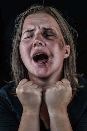Portrait of a young woman victim of domestic violence and abuse having nervous breakdown screaming. Imagens - 154370556