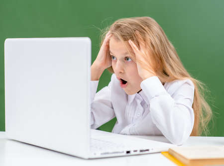 Shocked girl watch on screen of the laptop. Internet safety concept. Imagens - 155155162