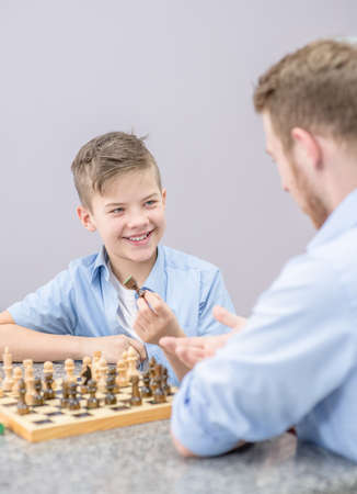 happy father and son play chess at home. Imagens - 155155099