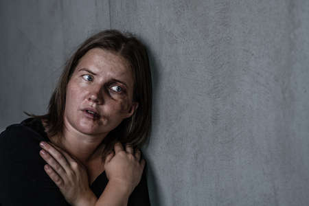Portrait of the woman victim of domestic violence and abuse looks on empty space. Empty space for text.