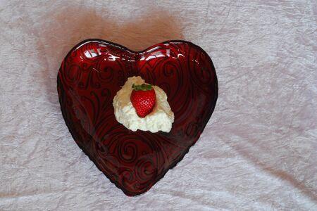 Erdeere with cream in heart