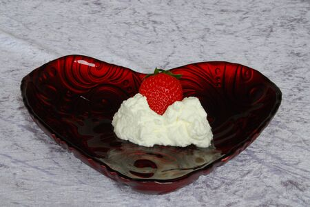 Strawberry and cream in bowl