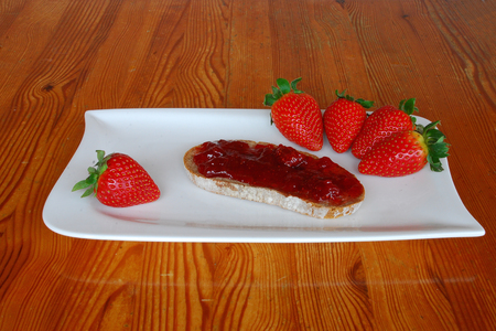 Strawberry with bread and jam