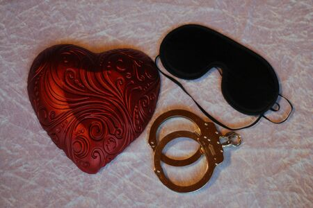 Heart with handcuffs Standard-Bild