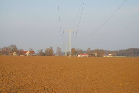 the distance: Electricity pylons in the distance Stock Photo