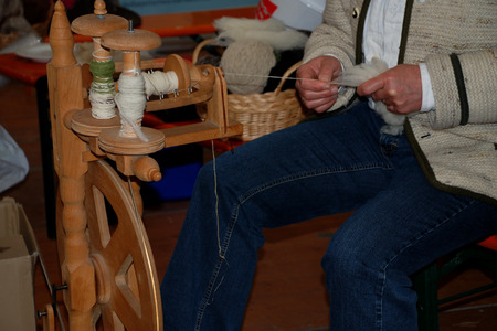 tracht: woman sitting at a spinning wheel Stock Photo