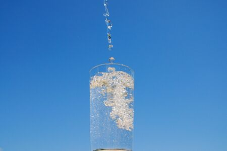Bubbling water in glass