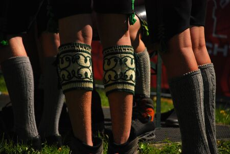 Legs by men in traditional Bavarian dress