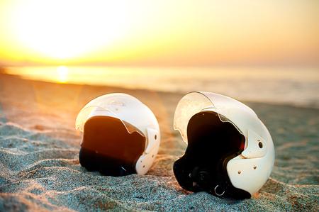 Two white helmets on the seashore sun