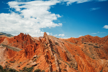 Red canyon, throats of rowers against the background blue sky Stock Photo