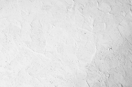 Decorative white plaster texture, seamless background. Grungy concrete wall, high detailed fragment stone wall.