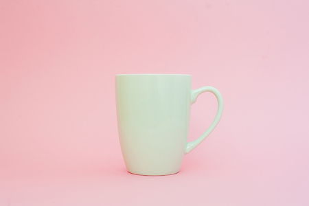 Cup of coffee on pink background. Mock up, copy space