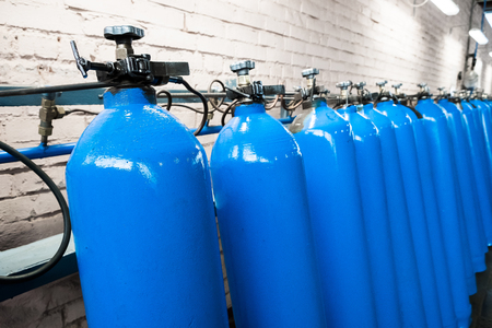 Oxygen cylinder with compressed gas. Blue Oxygen tanks for industry. Liquefied oxygen production. Factory Reklamní fotografie