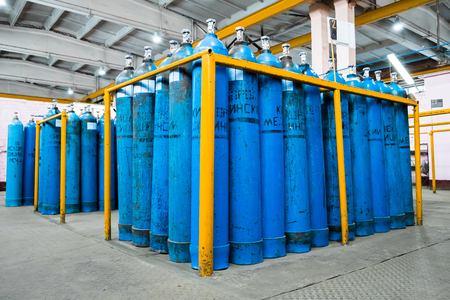 Oxygen cylinder with compressed gas. Blue Oxygen tanks for industry. Liquefied oxygen production. Factory Фото со стока