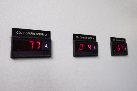 Control panel on factory. Heat exchanger, machine and pump in the industrial plant. Digital ammeter on control panel