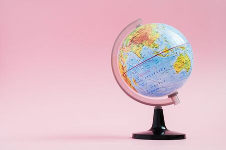 Adventure stories education background. World globe on pink background.