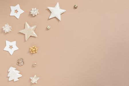 Christmas composition. Gifts, craft and golden decorations on white background. Flat lay, top view, copy space