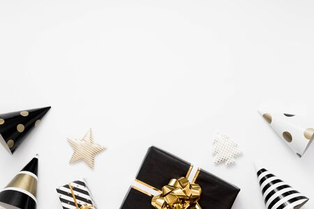 Christmas flatlay. Christmas gifts, black and golden decorations on white background. Flat lay, top view, copy space