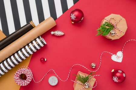Wrapping presents with colorful paper for Christmas holidays Wrapping Christmas gift in striped paper and decorating