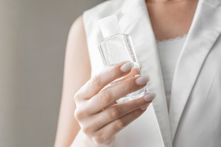 Women washing hands with antibacterial sanitizer gel. Hygiene concept. Prevent the spread of germs and bacteria and avoid infections corona virus.