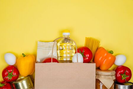 Donation box with various smart food. Paper bag. Food donations or food delivery service concept. Stock Photo