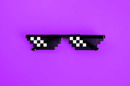 Funny pixelated boss sunglasses on purple background. Gangster, Black thug life meme glasses . Pixel 8bit style
