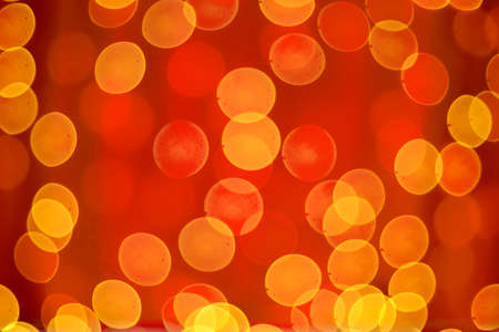 Abstract blurred bokeh lights on red background. Christmas and new year holidays light