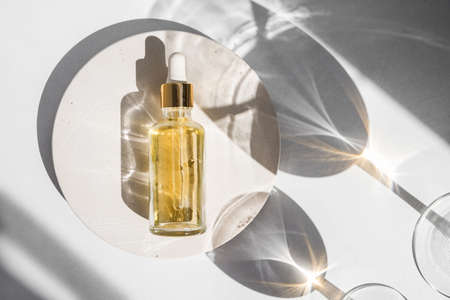 Dropper glass Bottle Mock-Up. Body treatment and spa. Natural beauty products. Eco cream, serum, skin care blank bottle. Anti-cellulite massage oil. Oily cosmetic pipette