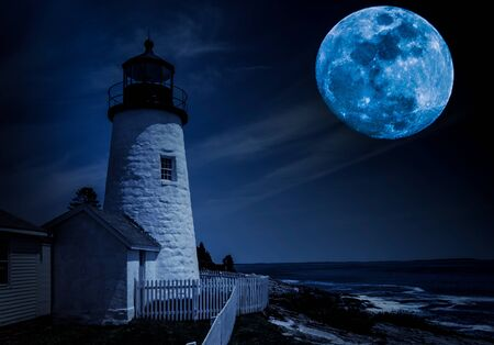 Historic 1827-lighthouse under the moonlight Stock Photo