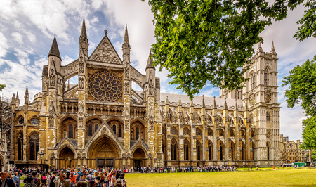 Multi-shop panorama of Westminster Abbey, London in high season.