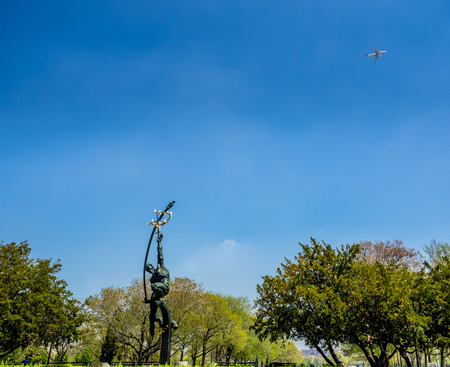 The Rocket Thrower in Flushing Meadows Corona Park, taking aim at a departing flight from La Guardia airport.
