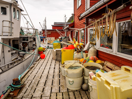 Typical Norwegian fishing village dock, complete with stockfish hanging out to dry. Banco de Imagens
