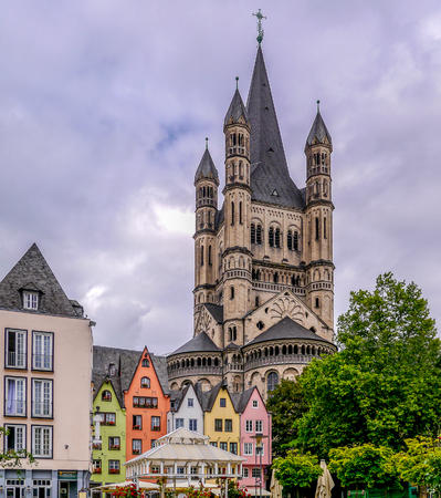 The colorful houses surrounding St Martins Church in old town Colgne Stock Photo