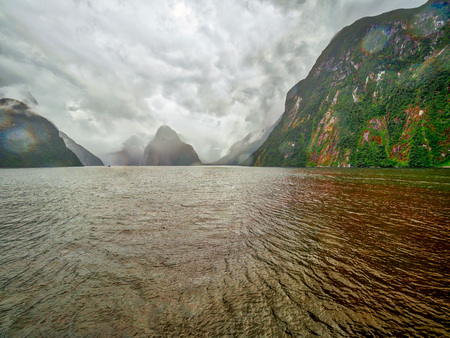 Although a very grey day, nothing that a little HDR cant sort out....  Milford Sound in New Zealand from the boat.