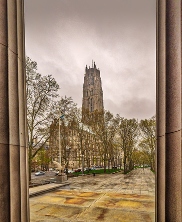 Storied, picturesque Gothic church with vivid stained-glass windows & 74 bronze bells.