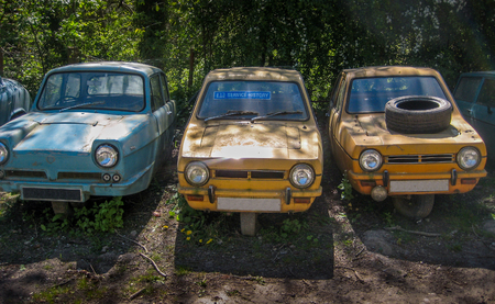 Abandoned and forlorn 3-wheeler cars in Denbigh, North Wales
