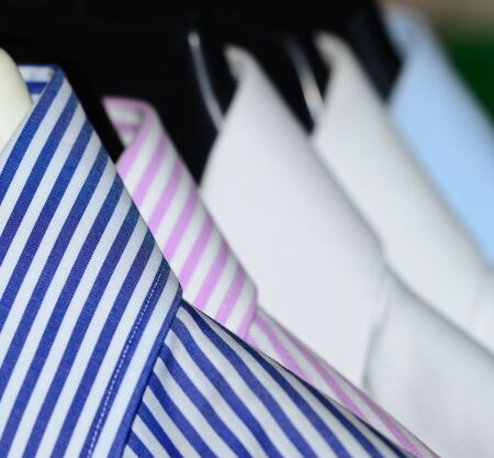 shirts on hangers: Dress shirts for men Stock Photo