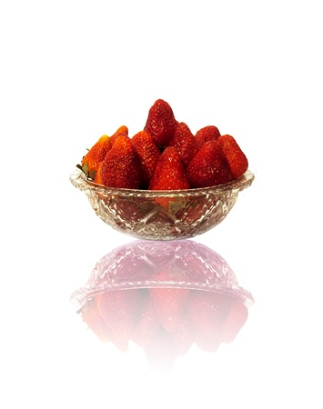 A glass dish with delicious and fresh strawberries Stock Photo - 17320934