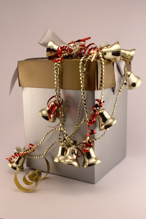 Christmas gift box with golden garland bells  Typical Christmas conceptual image  photo