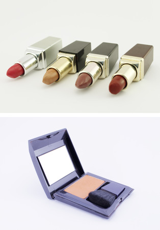 Six lipsticks and a make up set isolated. Conceptual image about the aesthetics and beauty of women. Stock Photo